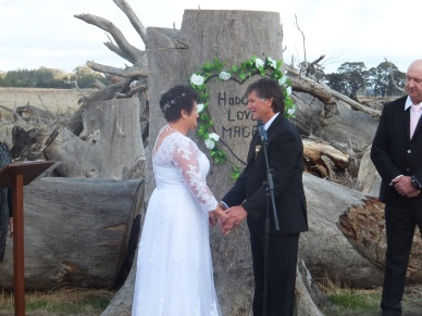 "Annette and Pete were married in front of a special tree stump. Pete had carved a heart with the words ""Hodgie loves Magpie"" into it for her birthday."